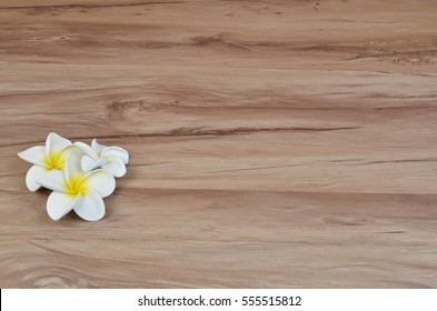 the flower decor frame on wood back ground