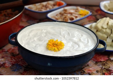 flower decorated sour cream in a pot