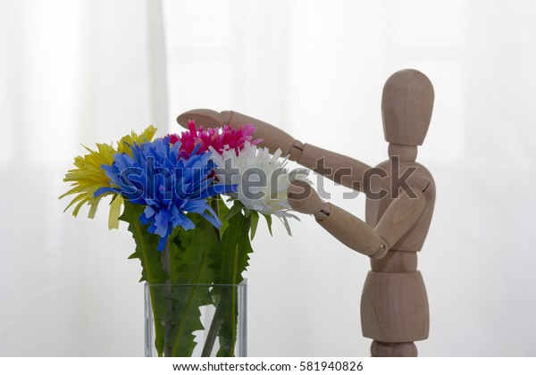 flower decoration in the house is made of fabric and wood robot