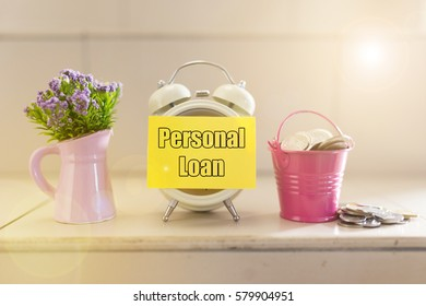 "flower decoration, mini pail full of coins, clock with sticky note written ""personal loan"""