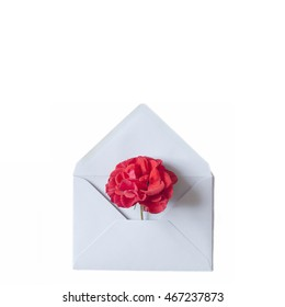 Flower in envelope on the white background. Mail for you. Spring background. Gift fot her. Flat lay. A grey envelope with the red rose.