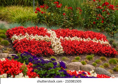Flower garden with red and white flowers illustrating the danish flag