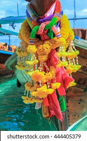 Flower garland on a long-tail boat on a beach of Ko Phi Phi Don, Phi Phi Islands, Thailand