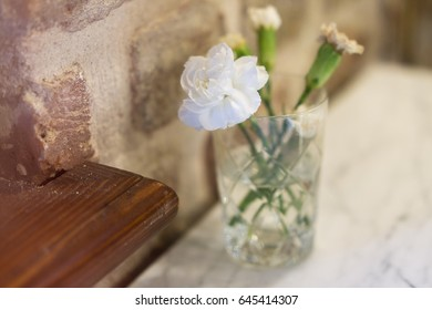Flower in glass on the table (interior)