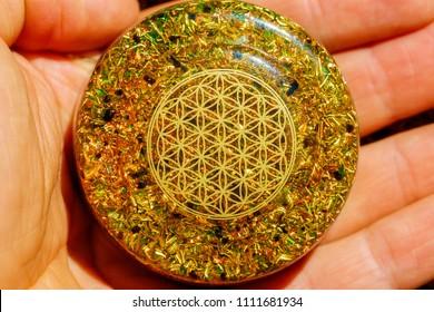 Flower of Life pattern. orgonite healing crystal.