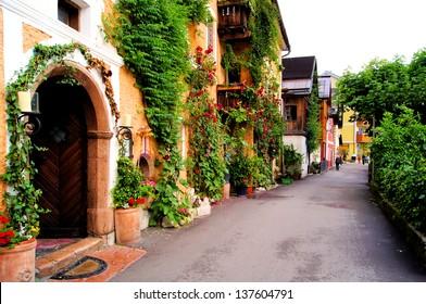 Flower lined street in the traditional Austrian village of Hallstatt