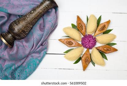 Flower made from national Azerbaijani Nowruz. Novruz sweets pakhlava and shekerbura