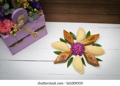 Flower made from national Azerbaijani Nowruz, Novruz sweets pakhlava and shekerbura