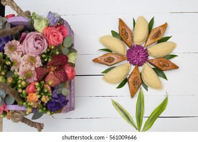 Flower made from national Azerbaijani Nowruz (Novruz) sweets pakhlava and shekerbura