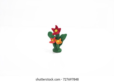 Flower made from plasticine. Isolated on white background.