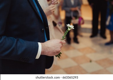 A flower in a man's hand