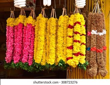 Flower market. Fresh flower garlands for sale during Onam celebrations. Flower garlands as offerings to temple deities.