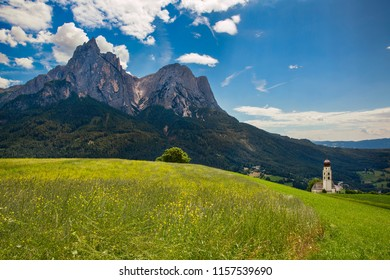 Flower Meadow and St Valentine's Church, Seis am Schlern, Italy, with the Impressive Mountain Schlern in the Background