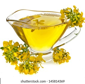 Flower mustard and Oil  in gravy boat isolated on white background