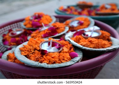 Flower offerings on the ghats, ready for the evening puja in Varanasi, India
