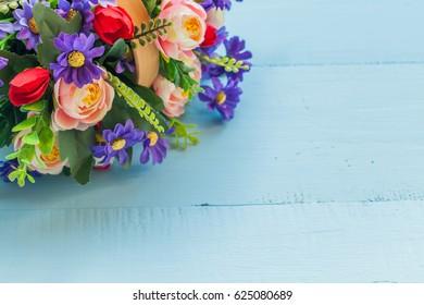 flower on color wood background