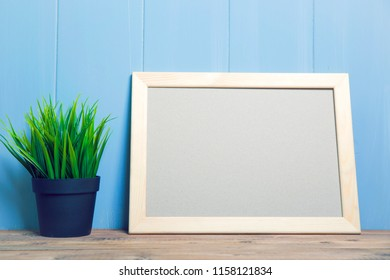 Flower on the table and frame for text