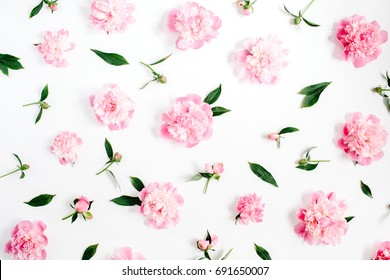 Flower pattern of pink peony flowers, branches, leaves and petals on white background. Flat lay, top view. Peony flower texture.