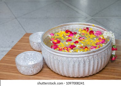 flower petals in a bowl with water. Used for watering ceremony Blessing the Elderly on Songkran festival.It is a tradition that continues to be ancient of Thailand.we used for monks and buddha statue