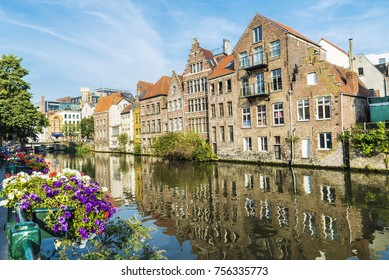 Flower pot along the Leie river with its typical houses in the medieval city of Ghent, Belgium
