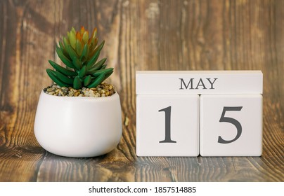 Flower pot and calendar for the warm season from 15 May. Spring time.