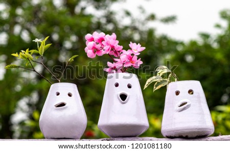Flower Pots With Smiling Faces