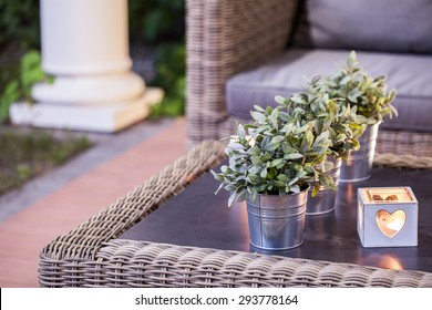 Flower pots and tealight on the table