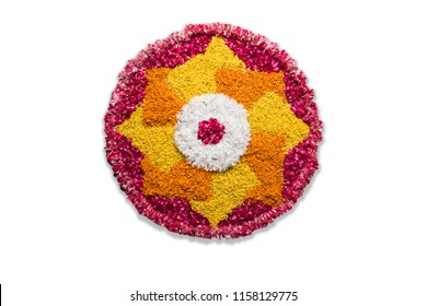 Flower rangoli for Diwali or Pongal or any hindu festival  using marigold or zendu flowers and red rose petals, selective focus