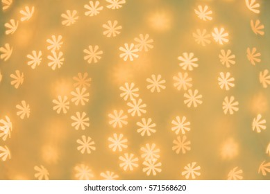 Flower shaped bokeh background. Wallpaper, texture and design.
