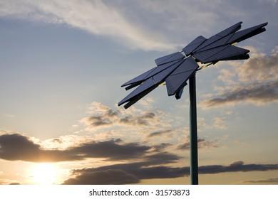 Flower shaped solar panel against setting sun