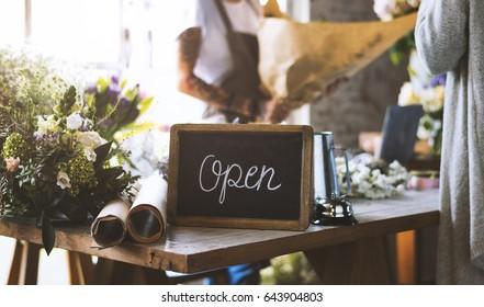 Flower shop is open on blackboard