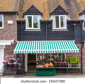A flower shop opened in an old house, seen in Rye, Kent, UK.