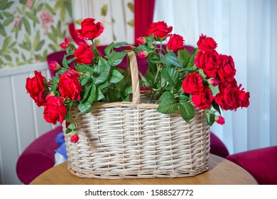 Flower Shop. Valentines Day . red artificial flowers are in the basket.Red roses Artificial Flowers selling in a basket.