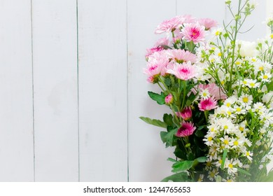 Flower with space of wood background