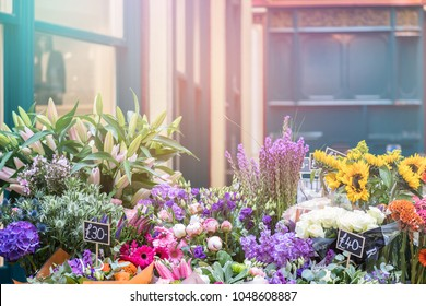 Flower stall with a variety of colourful bouquets for sale. Retro style processing with colourful light leaks