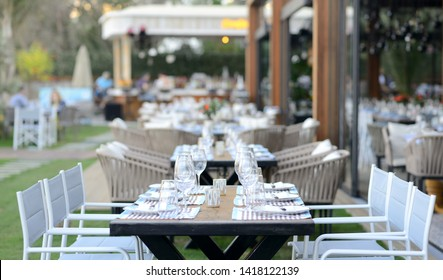 Flower table decorations for holidays and wedding dinner. Table set for holiday, event, party or wedding reception in outdoor restaurant. Luxury Table setting.Decorated table on a gala dinner party