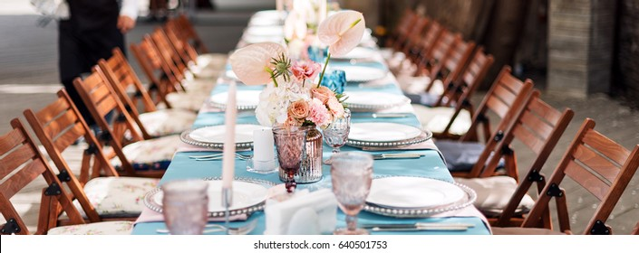 Flower table decorations for holidays and wedding dinner. Table set for holiday, event, party or wedding reception in outdoor restaurant. Banner for website.