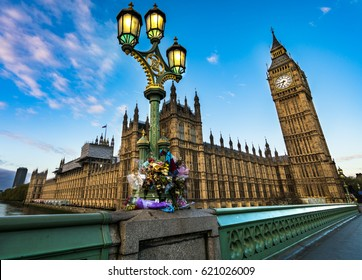 Flower tributes for the victims of the March 22,2017  terrorist attack at westminster bridge, big ben  and british parliament.