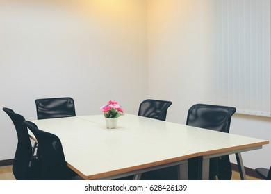 Flower vase on the table meeting in meetings room.