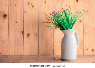flower vase white on wooden background.