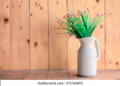 flower vase white on wooden background.