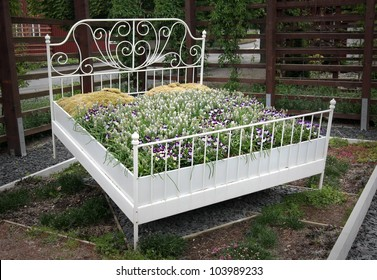 Flowerbed. A bed of flowers, literally. Symbol for innovative gardening and relaxation.