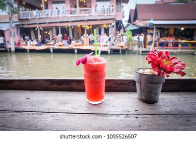 Flowerpot with fruit juice on the wood table, Amphawa floating Market in holidays, February 28, 2018 in Amphawa, Thailand.