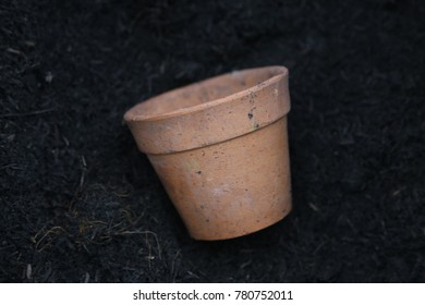 flowerpot lay down now the black soil.