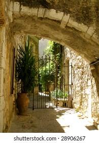 Flowerpot under a stone arch