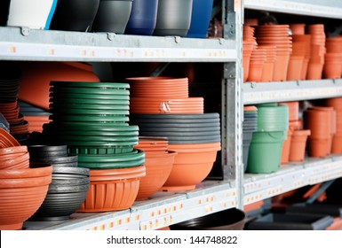 Flowerpots - Plastic flower pots on the metal shelf in hardware store.