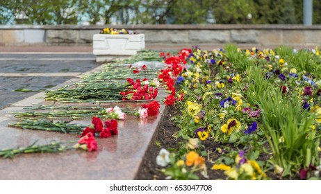 Flowers at abstract memorial