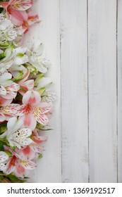 Flowers Alstroemeria. Bouquet of alstroemeria flowers on white wooded background