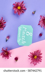 Flowers around greeting card. Celebration of 8th March.