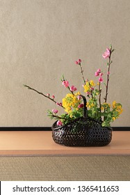 Flowers arrangement in basket, Japanese style